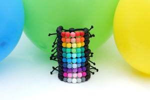 Dark ombre adjustable silicone bead bracelets in a rainbow of colours party pack