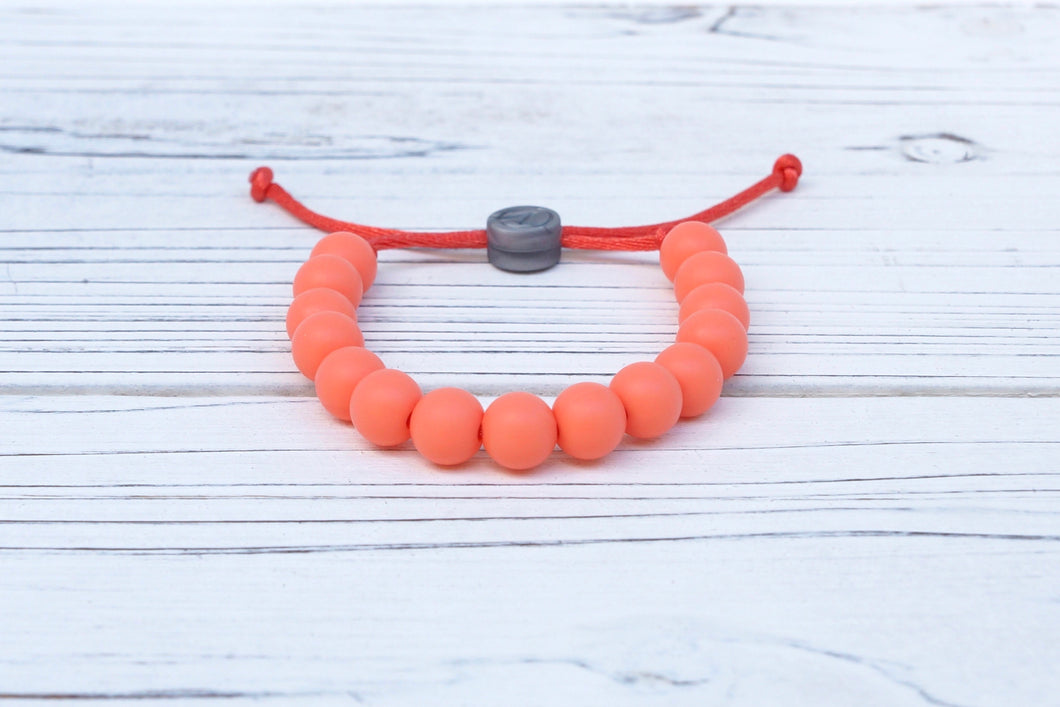 coral coloured adjustable silicone bead bracelet