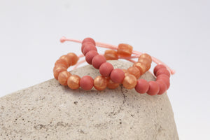 set of 2 rose gold and rose adjustable silicone bead bracelets