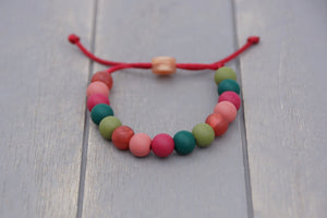 Muted Christmas colours adjustable silicone bead bracelet