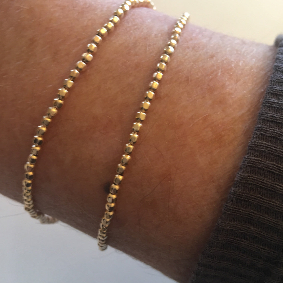 Gold beaded silk friendship bracelet