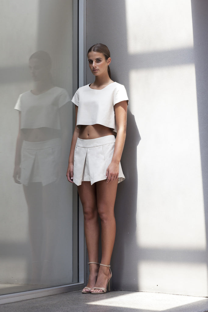 Image of 'Beat' Pleated Skirt in Bone Lambskin Leather - Side