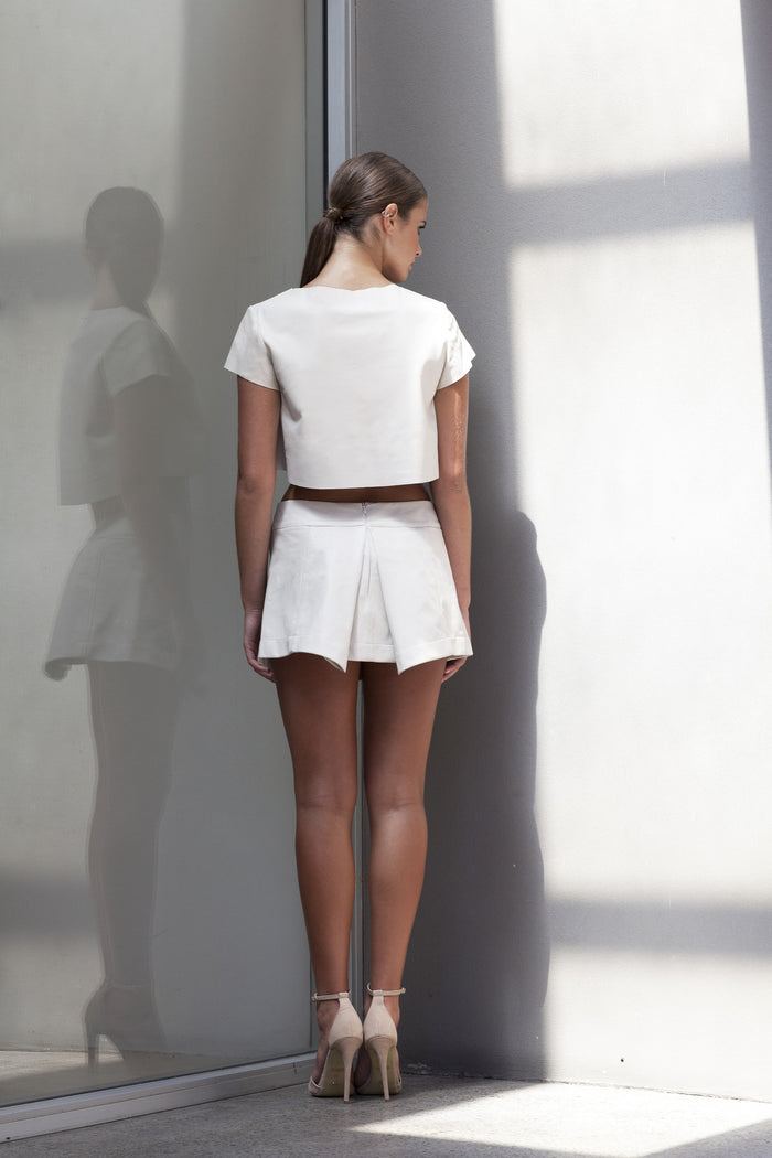 Image of 'Beat' Pleated Skirt in Bone Lambskin Leather - Back
