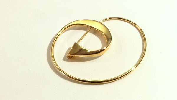Brooch in gold
