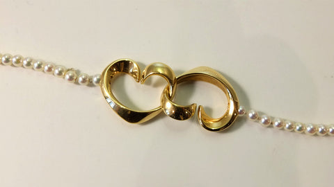 Hearts link in gold