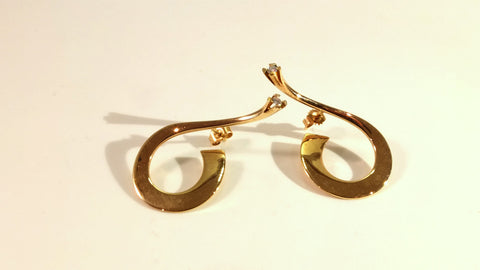 Earrings in gold with diamonds