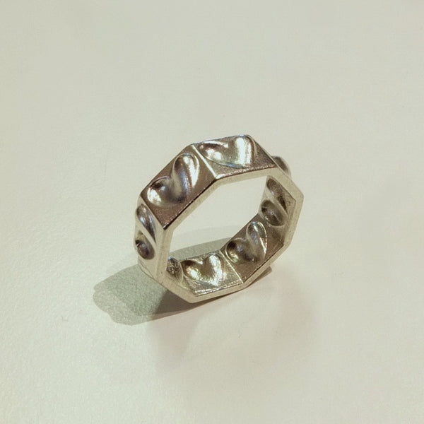 Half-hearted ring in silver