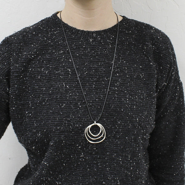 Medium Tiered Hammered Rings on Black Cord Necklace