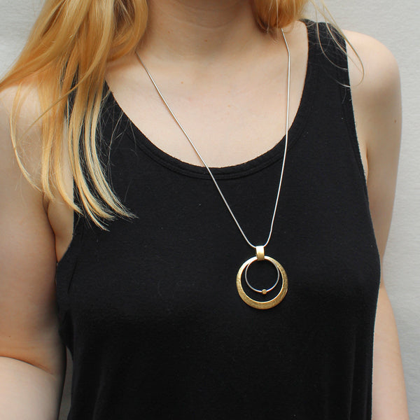 Cutout Disc with Ring and Bead Long Necklace