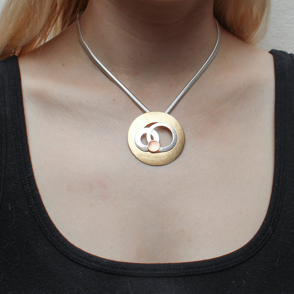 Large Cutout Disc with Layered Rings and Disc on Flat Snake Chain Necklace