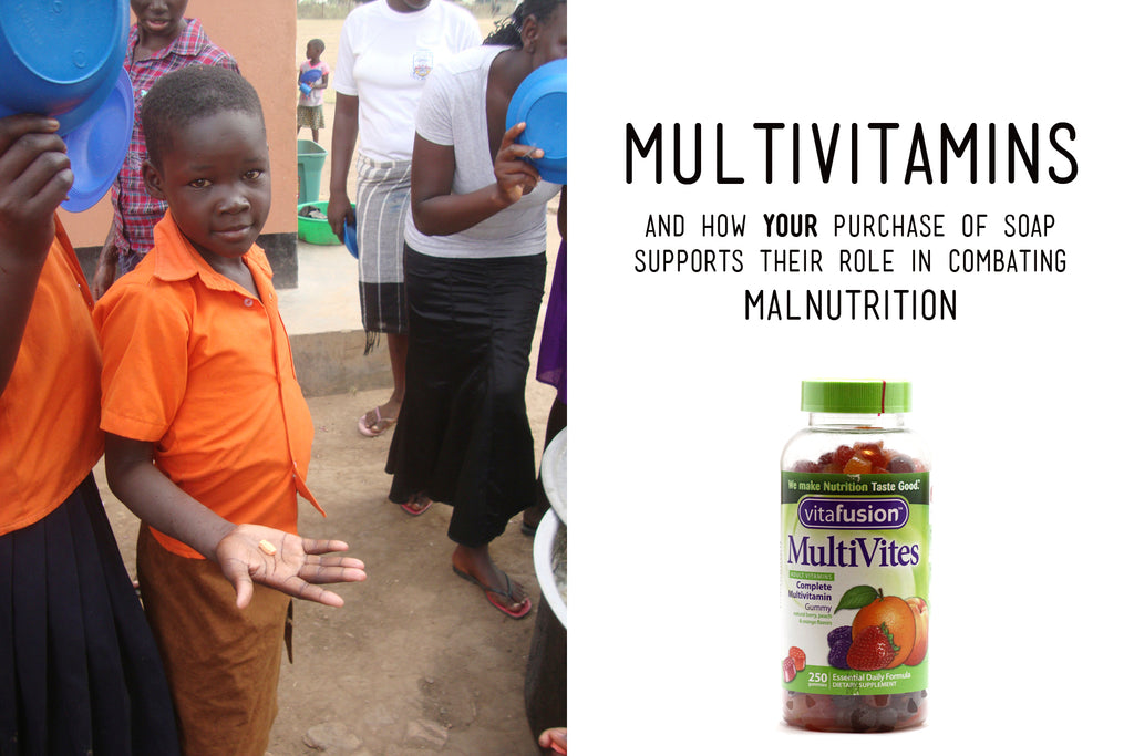 Ugandan boy holding a multivitamin in the palm of hand