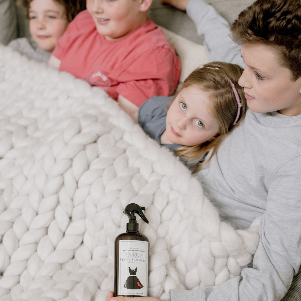 Static Schmatic Laundry Size with Kids under a cozy blanket for all natural static cling relief
