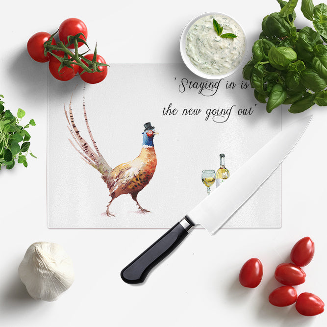 'Staying in is the new going out' Glass Chopping Board