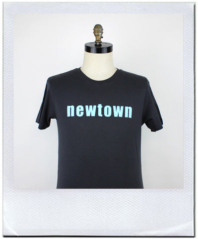 Newtown, the coolest suburb in the world. Mans T-shirt by duncan mclean, jeans shop Wellington, New Zealand