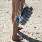 girls carrying hammam towel bags on beach