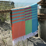 clara hammam towels hanging on rope