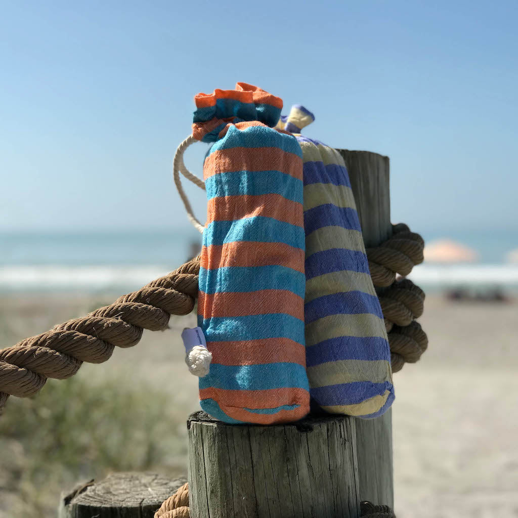 clara hammam towels on wooden post