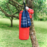 small navy dina terry backed towel on punchbag in garden