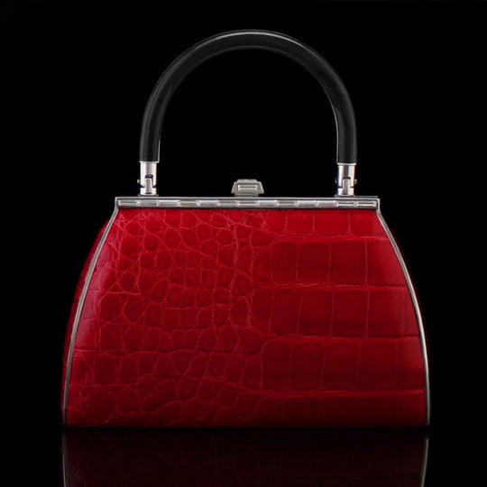 Alligator bag in red by designer german valdivia