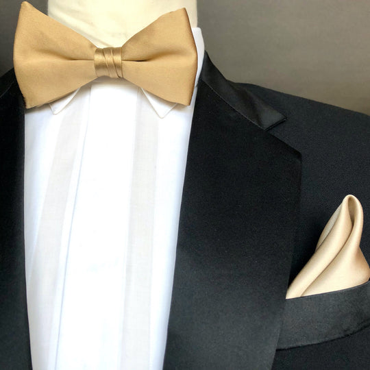 Gold silk pre tied bow tie with gold silk pocket square by German Valdivia