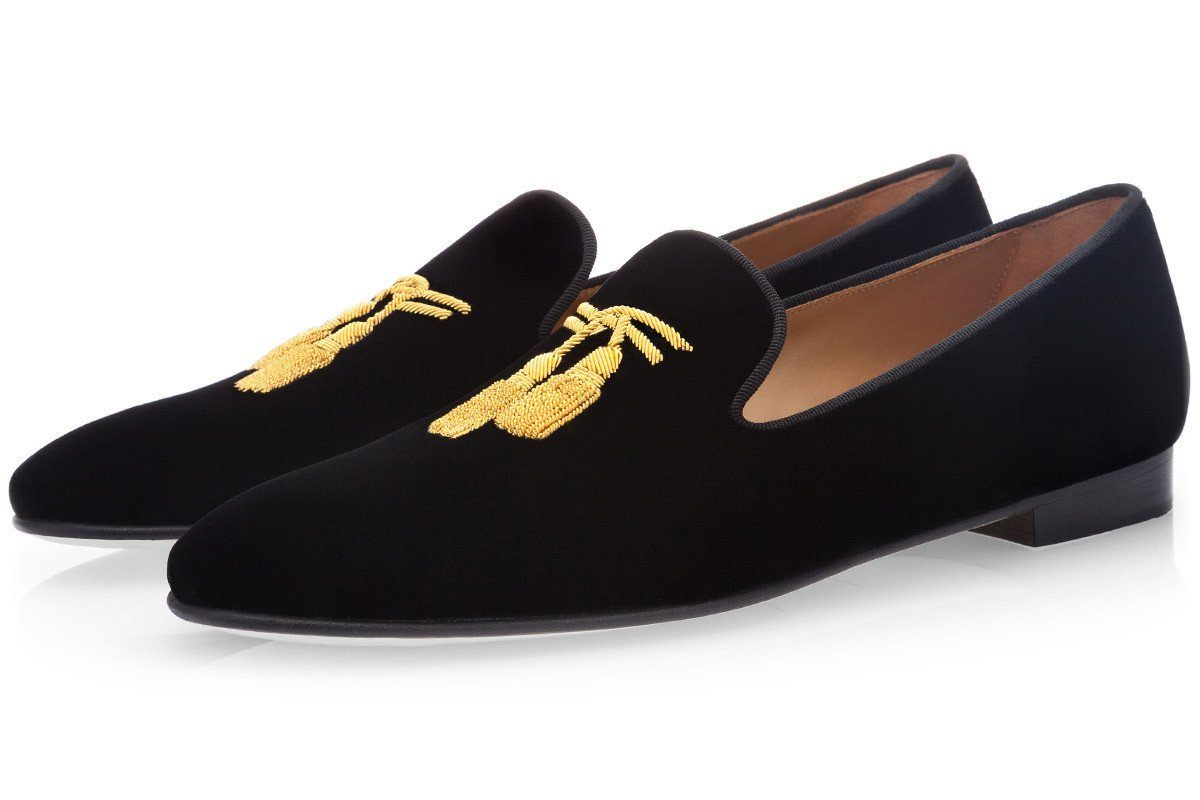 "Black velvet slippers with brand's signature ""Nappine"" bullion embroideries in gold"