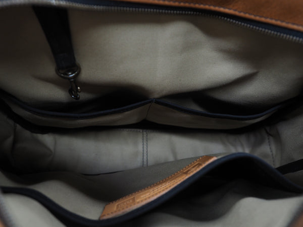 Inside of briefcase lined with 10.10 oz Khaki Army Duck.  Pocket for laptop on one side and two pockets on the other side.  Key clip attached to top interior.