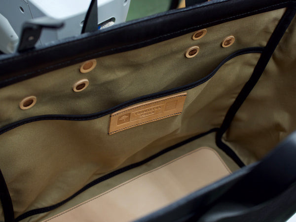 bag opened.  Laptop pocket with Vermilyea Pelle logo sewn to it.  Interior is Khaki duck canvas