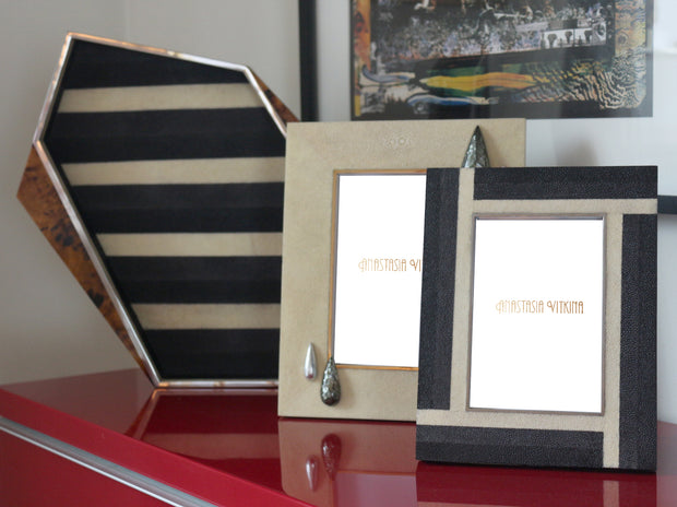This Exclusive Anastasia Vitkina tray & picture frames are rendered in an array of shagreen panels in black, charcoal and ivory, and features a natural look and a geometric shape.