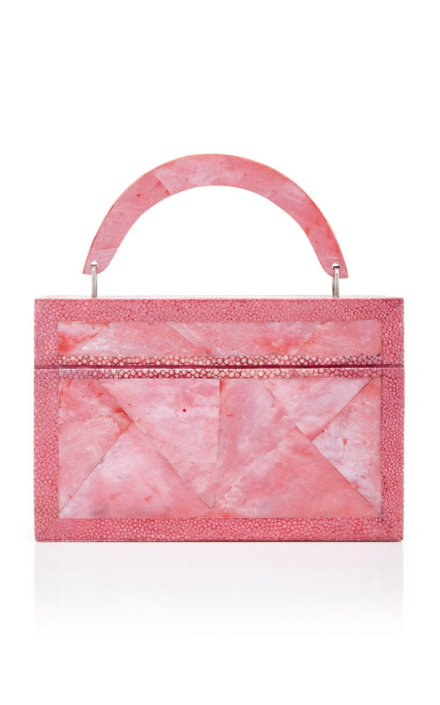 This LOVE BOX CLUTCH is rendered in pink mother of pearl shell and pink shagreen and features detachable chain strap and top handle option.