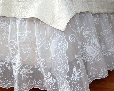 Charming dust skirt, embroidered with sunflower like pattern on 100% cotton organdy.