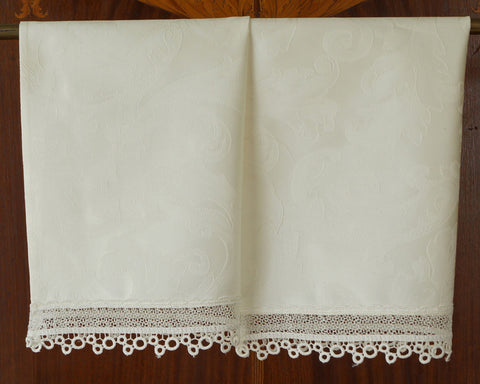 "Guest towel made from beautiful quality of Italian cotton damask and trimmed with dainty 2"" wide lace. All in soft cream color."