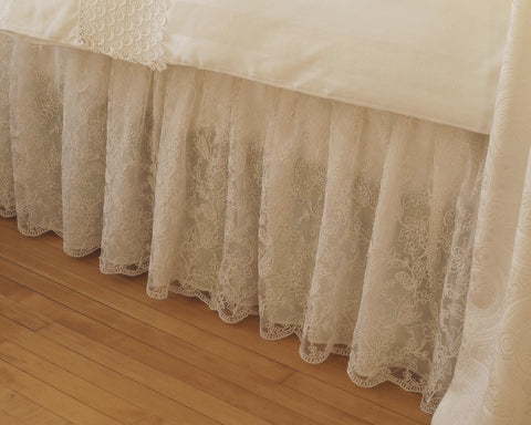 Exquisite dust skirt made from cream color lace with tulip design and lined with cotton voile.