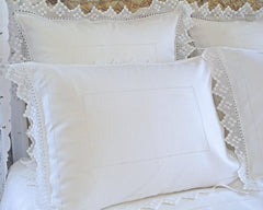 Linen pillow shams in standard and euro sizes. Simply adorned with hand drawn hemstitch and hand crochet flange.