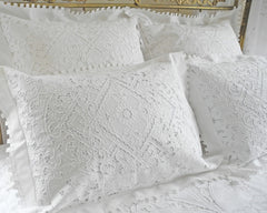 Standard pillow sham with very elaborate hand embroidery in cutwork and several types of drawnwork.