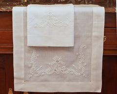 linen guest towel. Hand embroidered in white work type embroidery