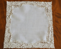 Lovely hankerchief in sheer white linen edged with exquisite lace in off white colour.