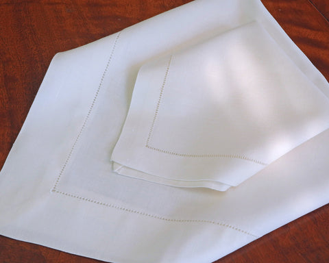 White linen/cotton napkin with hand drawn hemstitch.