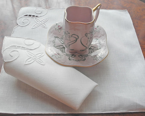 Cocktail napkin with hand embroidered motif in one corner. Linen/cotton blend.