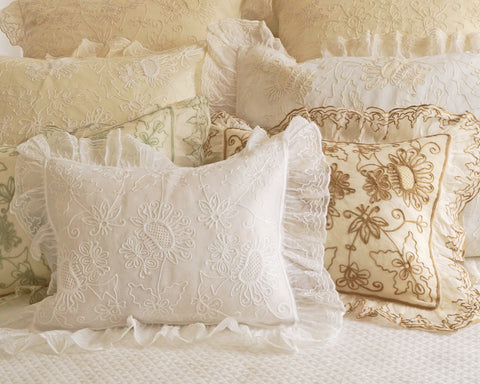 Organdy pillow shams with ruffled flange and embroidered with sunflower like motif . Boudoir, standard and euro sizes.