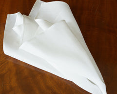 Oversize dinner napkin in pure white linen, finished with plain hem  border.