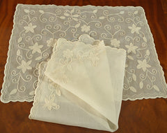 "Cotton organdy placemat and napkin set is embroidered with star like motif and finished scalloped edge. 20"" napkin has matching embroidery in 2 corners. Shown in ecru on ecru."