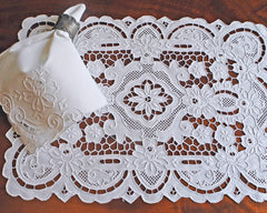 Placemat and napkin set, hand embellished with elaborate cut work and drawn work embroidery.
