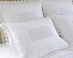 Pillow shams in standard and euro sizes. Embroidered by hand on fine quality of linen. Finished with hand crochet flange and crochet inset.
