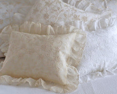 Boudoir pillow sham with ruffle, embroidered with star like pattern.