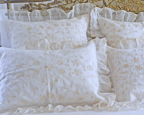 "Embroidered organdy pillow shams in standard and european square size. Finished with 3"" wide ruffle."