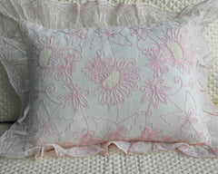 Boudoir size pillow sham, embroidered in pink yarn on ecru organdy. Framed with embroidered ruffle,