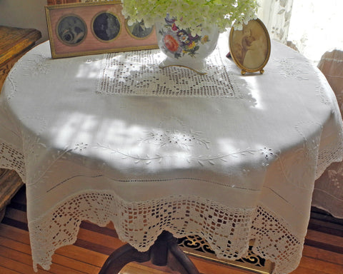 "Linen table topper (36"" square) hand embroidered and finished with crochet border and center inset."