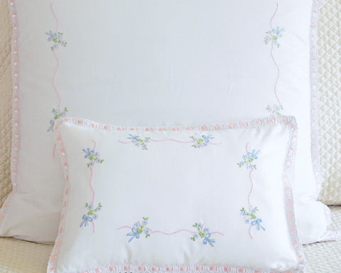 Pillow shams in european square and boudoir sizes. Embroidered with pink and blue yard. Edged with pink ribbon flange.