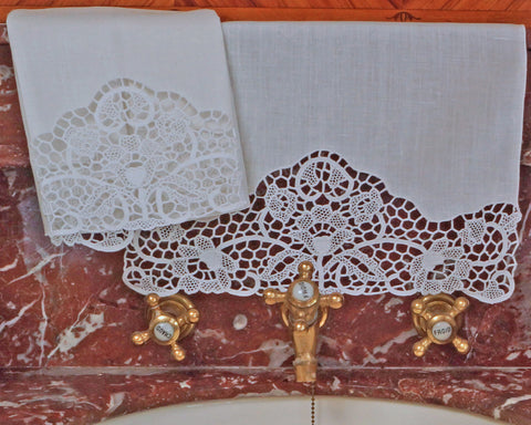 Luxury quality white linen guest towel embellished by hand with needle lace.