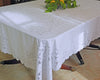 Dining tablecloth in 100% linen, embroidered by hand with drawn thread needlework.
